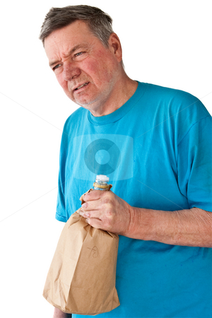 Distraught Mature Man with Booze stock photo, Distraught mature man with bottle of booze in paper bag, isolated on white background. by Steve Carroll