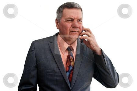 Portrait of Senior Businessman stock photo, Portrait of a senior businessman talking on cell phone with puzzled look on face, isolated on a white background. by Steve Carroll