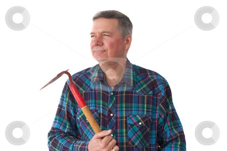 Portrait of mature gardener stock photo, Portrait of mature gardener holding hoe by Steve Carroll