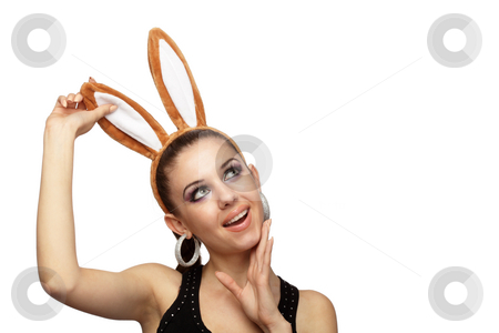 Young playful woman with bunny ears stock photo, Young playful woman with bunny ears over white by Ivelin Radkov