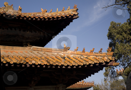 Roofs Confucius Temple, Qufu, Shandong Province, China stock photo, Roofs Confucius Temple, Qufu, Shandong Province, China  The figures on top of the temple are called in Chinese No Way Out.  The figure at the end resembles Confucius. by William Perry