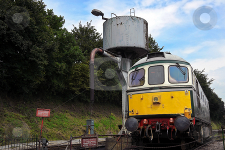 Diesel Train Engine stock photo, Diesel Train engine alongside water filler at Ropley Station by Robert Ford