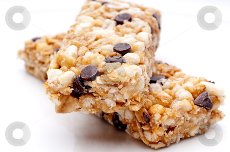 A horizontal close up of two granola bars on a white plate stock photo, A horizontal close up of two granola bars on a white plate by Vince Clements