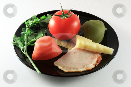 Healthy foods on plate stock photo, Ham, green parsley, cheese, pasta and tomato on a black plate by Varga S??ndor