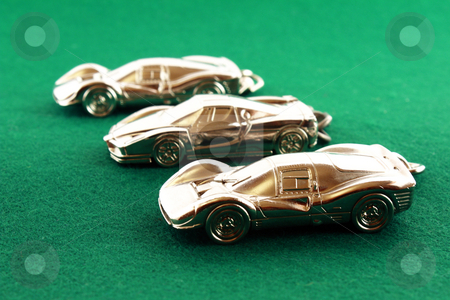 Three silver automobile models racing stock photo, Race of three silver automobile model on a green carpet by Varga S??ndor