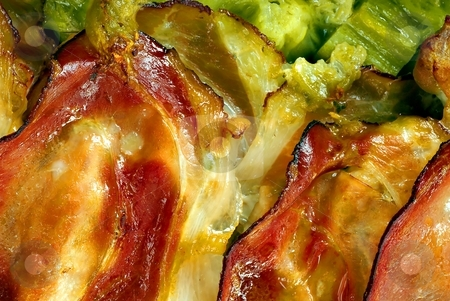 Baked prosciutto detail stock photo, Baked prosciutto with green herbs detail by Juraj Kovacik