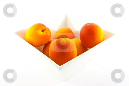Bowl of Apricots stock photo, Bowl of apricots on a white background with clipping path by Keith Wilson