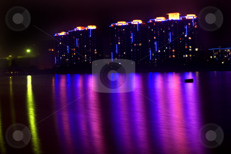 APARTMENTS LIGHTS HUN RIVER FUSHUN LIAONING PROVINCE  stock photo, Apartments at Night Hun River Fushun, Shenyang, Liaoning Province, China Trademarks removed. by William Perry