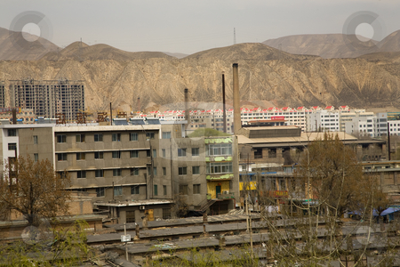 Chinese Factory with Chimneys Apartments Gansu Province, Qinghai stock photo, Chinese factory and chimneys apartments in front of mountains, Lanzhou City, Gansu Province, China by William Perry