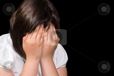 Crying Child stock photo, Closeup view of a young girl covering her face while she cries, isolated against a black background by Richard Nelson