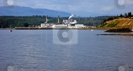 Seaside Industrial Plant stock photo, This seaside industrial plant is set against a beautiful ocean setting. by Valerie Garner