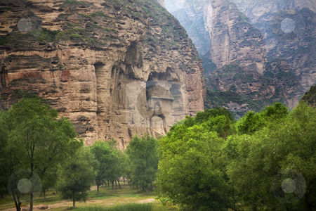 Buddha Statue Cliff Carving Binglin Si Buddhist Temple Lanzhou G stock photo, Buddha Statue Cliff Carving Binglin Si Bright Spirit Buddhist Temple Lanzhou Gansu China by William Perry