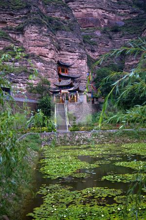 Binglin Si Bright Spirit Buddhist Temple Garden Lanzhou Gansu Ch stock photo, Binglin Si Bright Spirit Buddhist Temple Water Liliies Garden Cliff Lanzhou Gansu China by William Perry