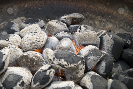 Glowing coals. stock photo, A hot barbecue grill with glowing coals. by Gert-Jan Kappert