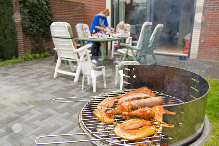 Meat and kebabs on barbecue. stock photo, Meat and kebabs on sizzling hot barbecue. by Gert-Jan Kappert