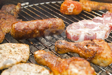Sausages, beef and other meat on a barbecue stock photo, Sausages, beef and other meat on a barbecue by Gert-Jan Kappert