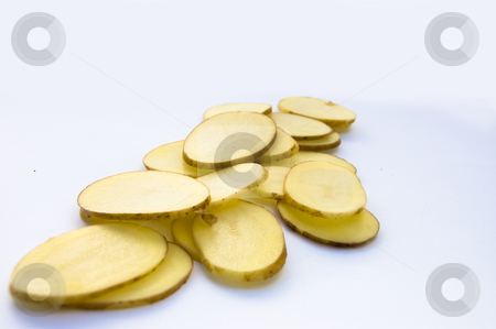 Sliced new potatoes stock photo, Close up frontal shot of sliced new potatoes on white background by Christian Rhein