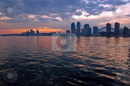 Toronto stock photo, Toronto skyline from Ontario lake in time of sunset by Pavel Cheiko