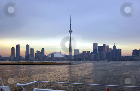 Toronto skyline stock photo, Toronto skyline from Ontario lake in time of sunset by Pavel Cheiko