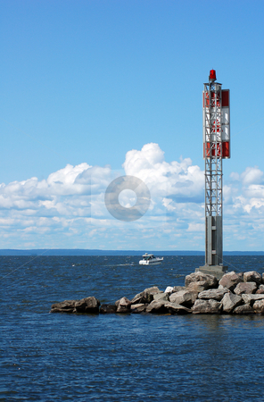 Lighthouse stock photo, Steel red and white lighthouse on the lake shore by Pavel Cheiko