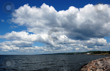 Lake stock photo, White and gray clouds above lake by Pavel Cheiko