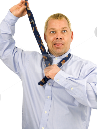 Man fixing tie stock photo, Man fixing his tie on a white background by John Teeter