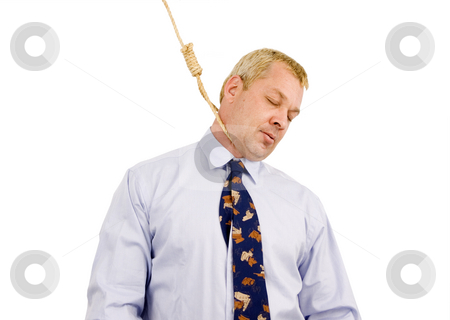 Business man with noose stock photo, Business man with noose around his neck hanging by John Teeter