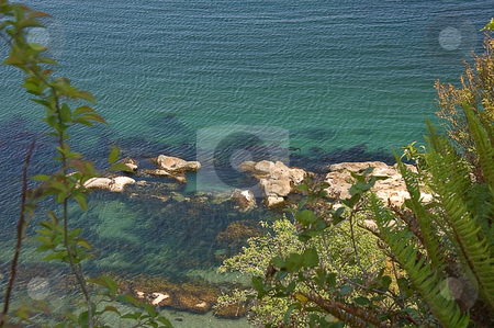 Looking Down at Ocean Scene in Washington stock photo, This vantage point is looking down from a cliff into an ocean scene in Washington state showing off beautiful turquoise rippled water from the wind. by Valerie Garner