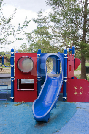 Playground stock photo, A playground with slides shaped into a boat by Kevin Tietz