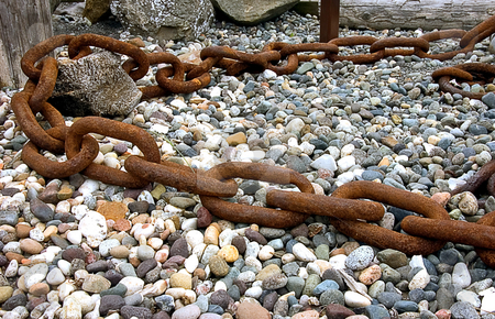 Very Large Rusty Chain stock photo, This is a very large link rusty chain with rocks and pebbles in the background and foreground. by Valerie Garner