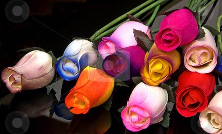 Handmade Wood Roses on Black stock photo, These colorful roses are handmade out of wood and are set on a black background. by Valerie Garner