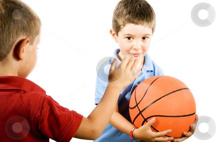 Kids playing Basketball stock photo, Stock photo of boys playing basketball, isolated on white by iodrakon