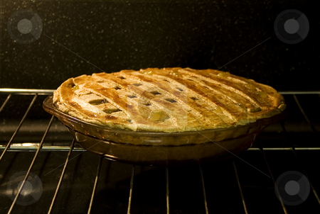 Pie in Oven stock photo, Stock photo of pie in the oven, focus on foreground by iodrakon