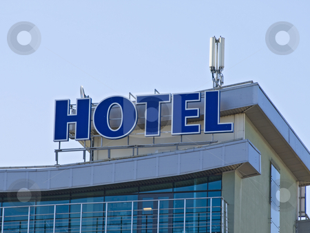 Hotel stock photo, Hotel signs at the building against the blue sky by Sergej Razvodovskij