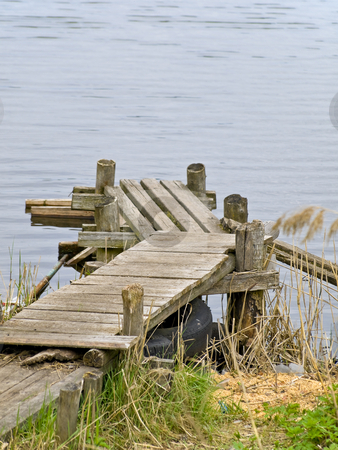 Lake planked footway stock photo, Wooden planked footway at the lake in the nature by Sergej Razvodovskij