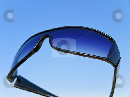 Sun glasses stock photo, Sun glasses against the blue sky by Sergej Razvodovskij