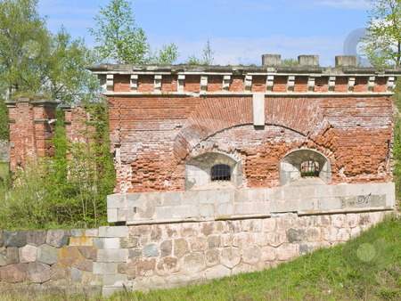 Part of the stronghold stock photo, Part of the old bricks stronghold against the wild nature by Sergej Razvodovskij