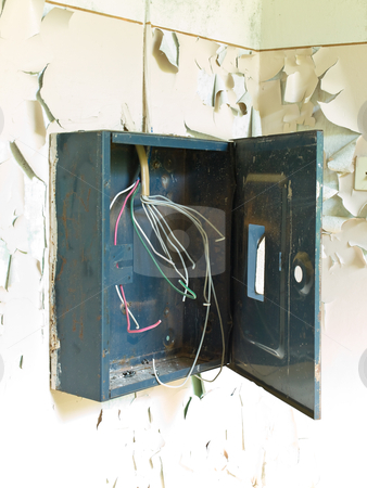 Electric board stock photo, Old electric board on the scuffed wall by Sergej Razvodovskij