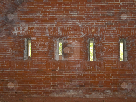 Loopholes stock photo, Row of narrow loopholes in the red brick wall by Sergej Razvodovskij