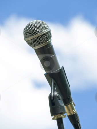 Single microphone stock photo, Single microphone against the blue sky with clouds by Sergej Razvodovskij