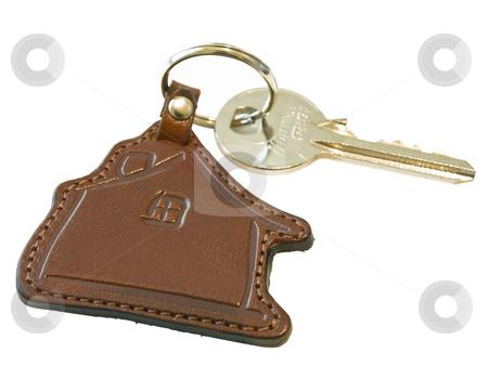 House key stock photo, Isolated house key against the white background by Sergej Razvodovskij