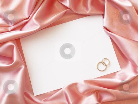 Textile border with golden rings  stock photo, Pink silk textile border round white paper with golden rings by Sergej Razvodovskij