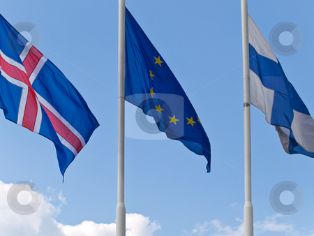 Flags stock photo, Three different flags against the blue sky by Sergej Razvodovskij