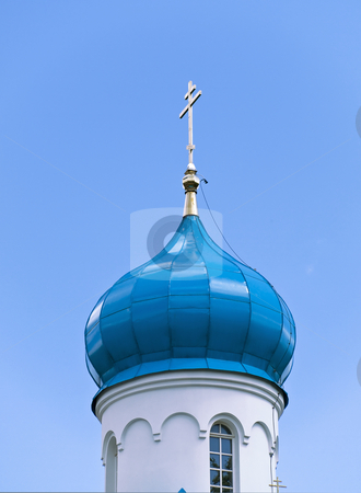 Cupola stock photo, Blue cupola of the church with gold cross against the blue sky by Sergej Razvodovskij