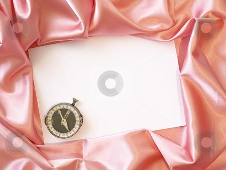 Textile border with compass  stock photo, Pink silk textile border round white paper with compass by Sergej Razvodovskij