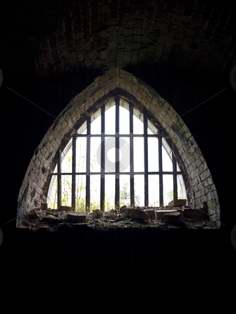 Arch window stock photo, Old arch window with metallic treillage in dark by Sergej Razvodovskij