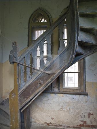 Old spiral stairs stock photo, Old spiral stairs in tower wih arch windows by Sergej Razvodovskij
