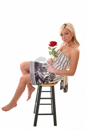 Girl on stepladder. stock photo, Pretty young girl in a black and white dress with long blond hair sitting on an wooden chair, looking in the camera. by Horst Petzold