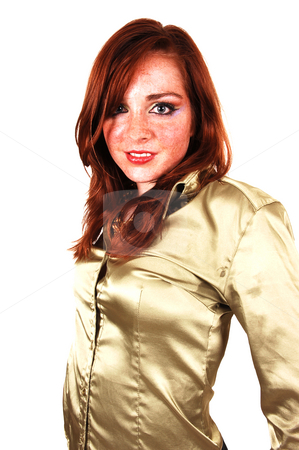 Portrait of young girl. stock photo, A close-up shot of a young girl with bright red hair and an gold colored blouse for white background. by Horst Petzold