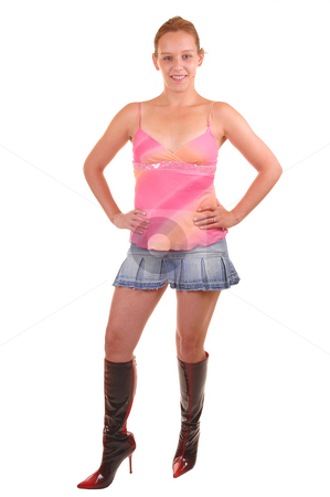 Woman in skirt and boots. stock photo, An portrait picture of a young woman in mini skirt and long boots, smiling,  shoing her nice legs, for white background. by Horst Petzold